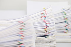 Pile paperwork have blur overload document as foreground and background. Pile overload paperwork of report with colorful paperclip have blur pile overload Royalty Free Stock Image
