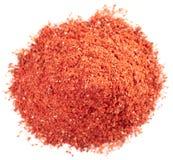 Pile of paprika powder macro shot, isolated Royalty Free Stock Images