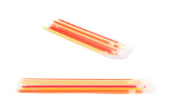Pile of party glow sticks. Isolated over the white background, set of two different foreshortenings Stock Photo