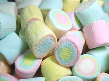 Pile of Pastel Yellow, Pink, Blue Colored Puffy Marshmallows. Texture, Background Stock Photo