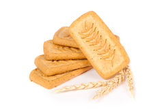 Pile of pastry cookies with wheat isolated on white background Royalty Free Stock Photos