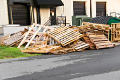 Pile of Pattets. A pile of wooden pallets iby a loading dock of a warehouse Stock Photos
