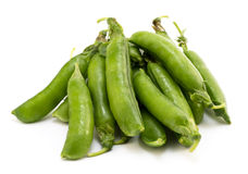 Pile of pea pods isolated. On white Royalty Free Stock Images