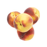 Pile of peach fruits isolated Stock Images