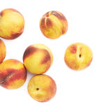 Pile of peach fruits isolated Royalty Free Stock Photos