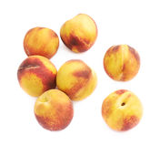 Pile of peach fruits isolated Stock Image