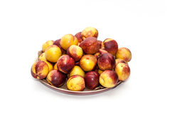 Pile of peaches. On a plate Royalty Free Stock Photos