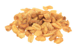 Pile of Peanuts. A stock photo of a pile of peanuts set against a white background Stock Photography