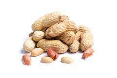 Pile of peanuts with nutshells on white background. Pile of peanuts with nutshells isolated on white background Stock Photography