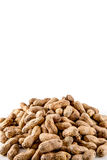 Pile of Peanuts. A pile of salty peanuts isolated on white Stock Photos