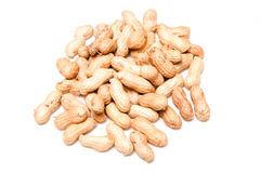 Pile of peanuts in shells. Pile of peanuts or groundnuts in shells, isolated on white background Royalty Free Stock Images