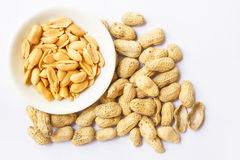 Pile of peanuts on white Stock Photo