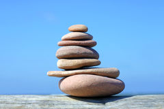 Pile of pebble stones. Against clear blue sky Royalty Free Stock Images