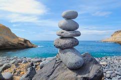 Balancing on the seacoast Royalty Free Stock Image