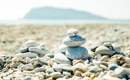 Pile of pebbles on the beach at Alanya Mediterranean sea coast, Turkey.  Balance, relaxation and harmony concept Royalty Free Stock Images