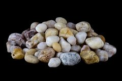 Pile of Quartz and Pebbles on a Black Background royalty free stock photos