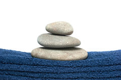Pile of pebbles on the towel Royalty Free Stock Photo