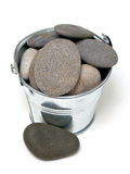 Pile of pebles in a metal bucket Royalty Free Stock Images