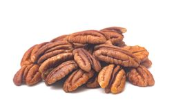 Pile of pecan Halves. Pecan Halves on a White Background royalty free stock photography