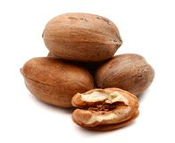 Pecan Nuts isolated on white. Pile of pecan nuts isolated. Healthy, protein Stock Photography