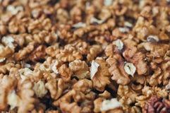 Pile of peeled English walnut. Natural background Stock Photo