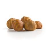 Pile of peeled hazelnuts. Over white background stock photo