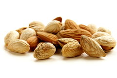 Pile of peeled and inshell almonds Stock Photos