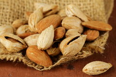 Pile of peeled and inshell almonds Royalty Free Stock Photo