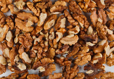 Pile of peeled walnuts close-up as abstract food background Stock Images
