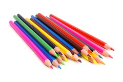 Pile of pencil crayons. Cluster of colorful pencil crayons over a white background Stock Image
