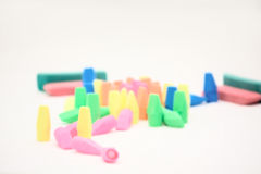 Pile of Pencil erasers for school supplies. Pile of erasers for school supplies on a white background. Focus is on the yellow eraser standing next to the pink Royalty Free Stock Image