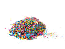 Pile of pencil's graphite chips shavings isolated. Pile of pencil's colorful graphite chips shavings isolated over the white background Stock Photos