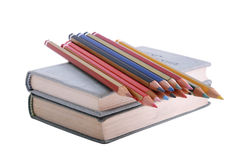 Pile of pencils and pair of books Royalty Free Stock Image