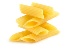 Pile of penne in balance. On white background Royalty Free Stock Photo