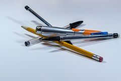 Pile of pens and pencils. Pile of pens and penciles on white Royalty Free Stock Image