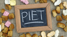 Pile of pepernoten. A chalkboard with the text Piet and a pile of Pepernoten, typical Dutch treat for Sinterklaas on 5 december Royalty Free Stock Images