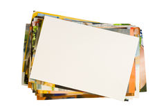 Pile of photographs with empty frame. For your photo isolated on white background stock image