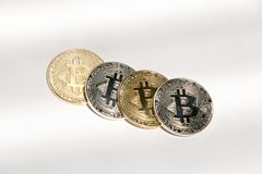 Bitcoins. Pile of physical bitcoin, gold and silver Stock Images
