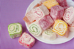 Pile of pieces of turkish delight lokum on a white background. Top view Stock Photo