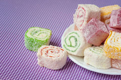Pile of pieces of turkish delight lokum on a white plate Stock Photo