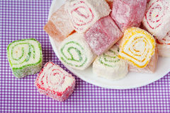 Pile of pieces of turkish delight lokum on a white plate. Top view Stock Images