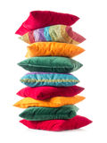 Pile of pillows. Pile of colorful pillows over white background Royalty Free Stock Photo