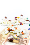 Pile of pills and banknotes closeup Stock Image