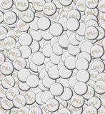 Pile of Pills with Blank. Background image shows large pile of pills with blank area for personalization.  Each tablet is white and the word PILL is embossed on Royalty Free Stock Images