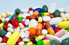 Pile of pills in medicine container Stock Image