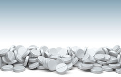 A pile of pills and tablets. Isolated on a white background Royalty Free Stock Image