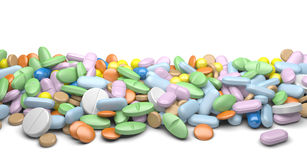 A pile of pills and tablets. On a white background Royalty Free Stock Image