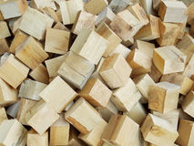 Pile of pine cubes. Raw material Royalty Free Stock Photography