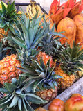 Pile of pineapples at market Royalty Free Stock Images