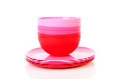 Pile of pink plastic plates and bowls Stock Images